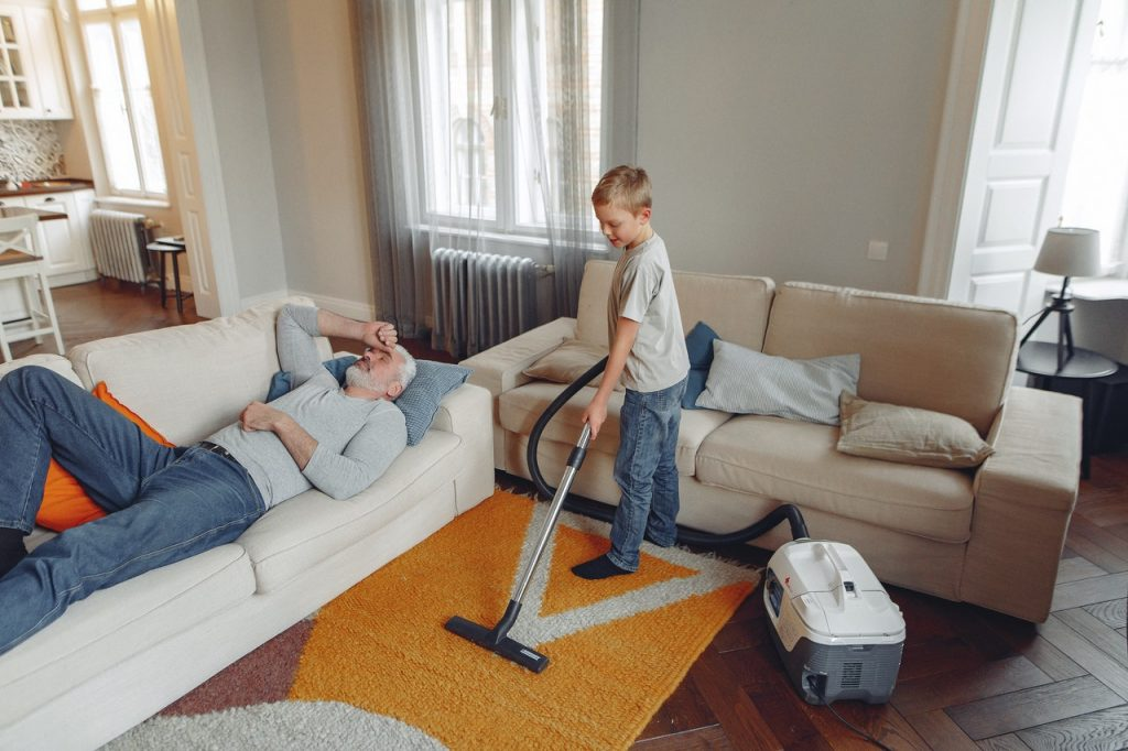 Boy Cleaning the Living Room