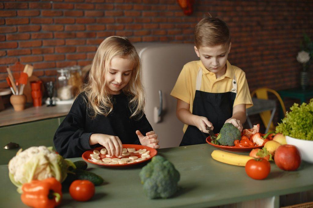 Children Slicing Vegetables