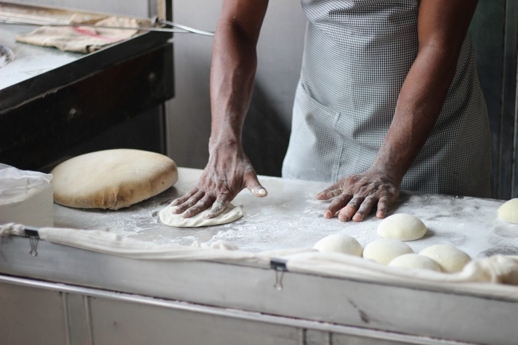 Man Preparing Dough to Make Bread
