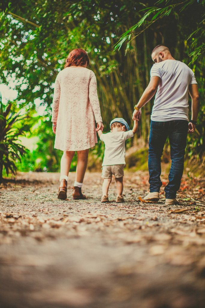 Parents Taking a Walk with Son
